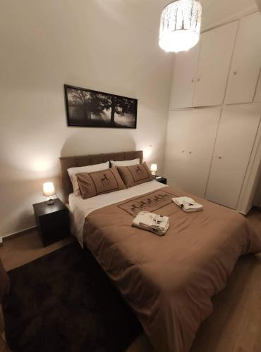 A bed or beds in a room at Apartment @Katehaki Metro