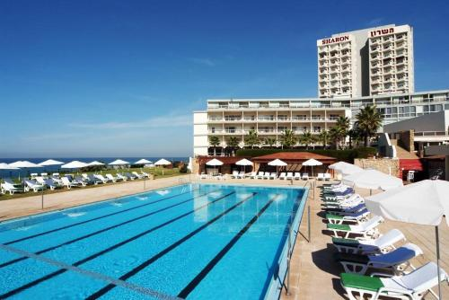 The swimming pool at or near Sharon Hotel Herzliya
