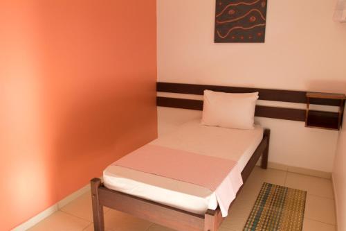 Cama ou camas em um quarto em Pousada Terceiro Espaço