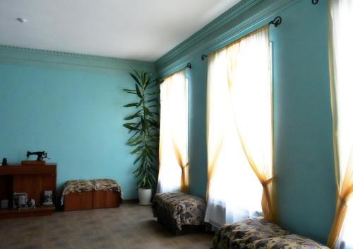 """Кровать или кровати в номере Гостевой дом """"Купец Осипов"""""""