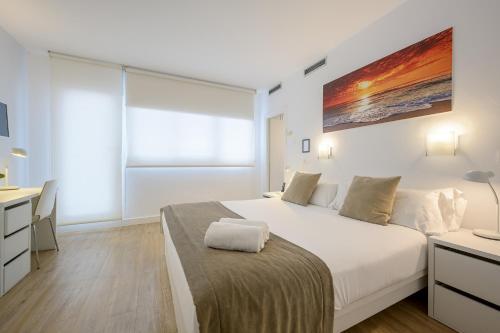 Cama o camas de una habitación en NeoMagna Madrid