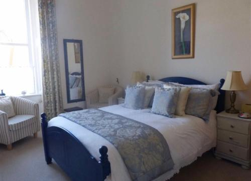 A bed or beds in a room at Abertay Guest House