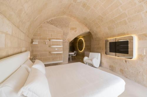 Letto o letti in una camera di Aquatio Cave Luxury Hotel & SPA
