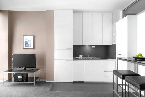 A kitchen or kitchenette at Mantra 100 Exhibition