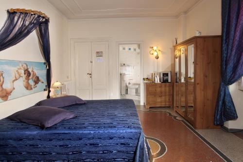 Łóżko lub łóżka w pokoju w obiekcie B&B DolceVirginia