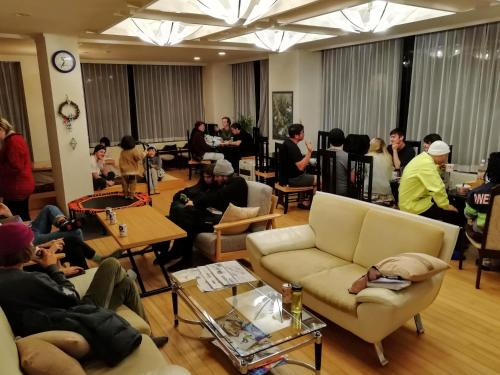 A restaurant or other place to eat at K's House Hakuba Alps - Travelers Hostel