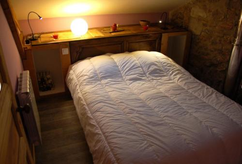 Un ou plusieurs lits dans un hébergement de l'établissement Gîte La Grange