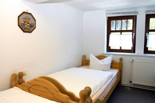 Ein Bett oder Betten in einem Zimmer der Unterkunft Pension Landhaus Machold