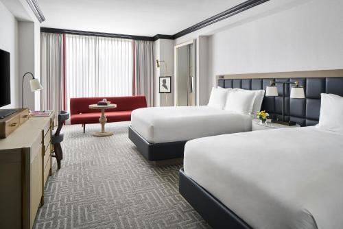 A bed or beds in a room at The Ritz-Carlton, Washington, D.C.