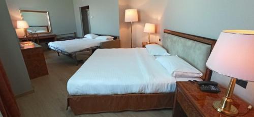 Letto o letti in una camera di Tower Genova Airport - Hotel & Conference Center