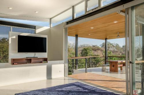 A television and/or entertainment center at Modern Beach House with Stunning Views - Sleeps 4