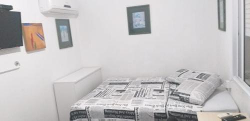 A bed or beds in a room at Homestay Porto Alegre