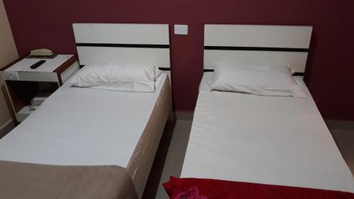 Cama ou camas em um quarto em Top Mix Hotel