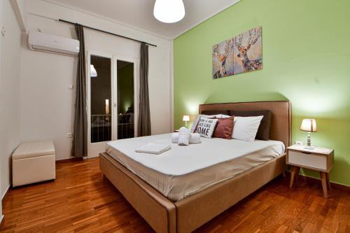 Postel nebo postele na pokoji v ubytování The Athens City Getaway