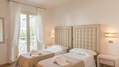 Letto o letti in una camera di Hotel Alta La Vista