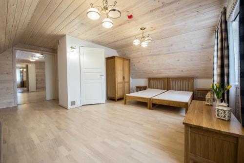 Кровать или кровати в номере Panemunio sodyba
