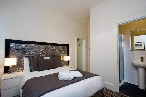 A bed or beds in a room at The Guest House Broadstairs