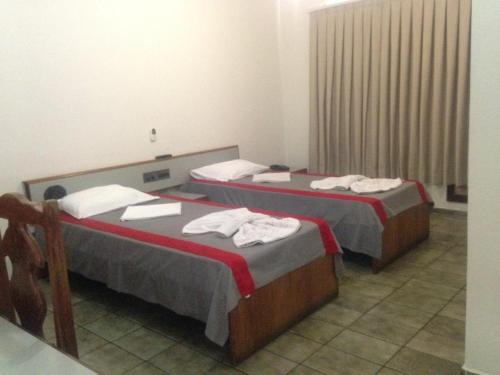 A bed or beds in a room at Mediterraneo Hotel