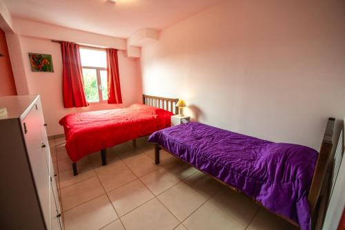 A bed or beds in a room at Oshovia Hostel