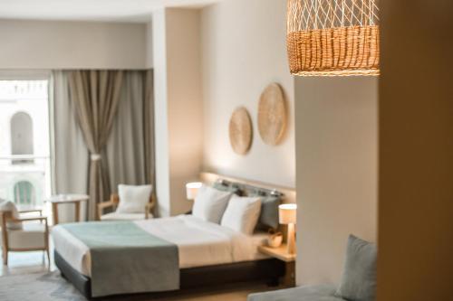 Redcon Panorama tesisinde bir odada yatak veya yataklar