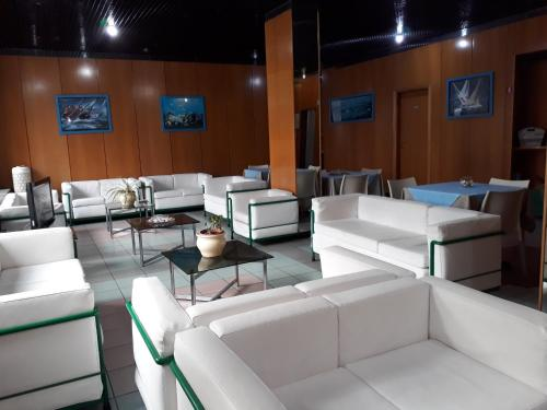 The lounge or bar area at Hotel Neptunus