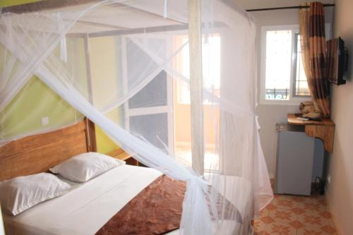 A bed or beds in a room at Africa 6 Plage