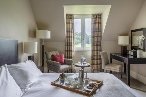 A bed or beds in a room at Bowood Hotel, Spa, and Golf Resort
