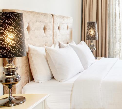 Letto o letti in una camera di Dioni Boutique Hotel
