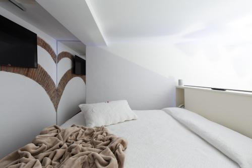 Krevet ili kreveti u jedinici u okviru objekta Agave in Città