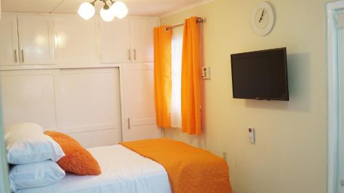 Cama ou camas em um quarto em Tranquility Place