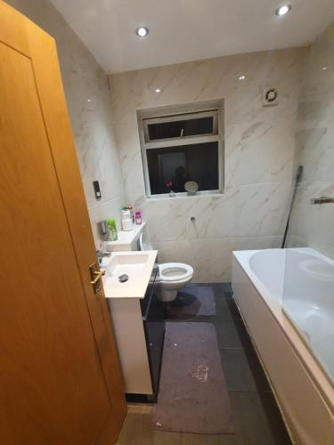 A bathroom at Double Room in a House