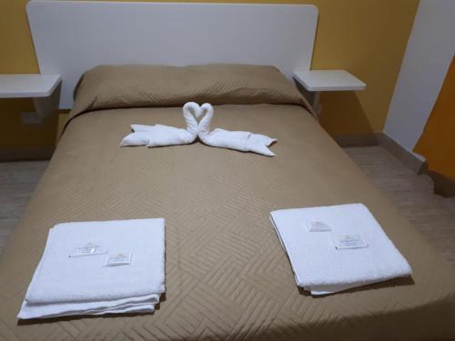 Una cama o camas en una habitación de departamento El Tano