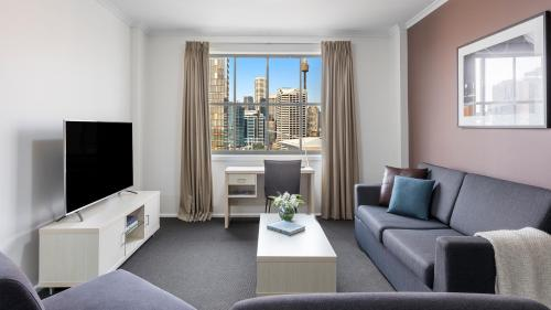 A seating area at Oaks Sydney Goldsbrough Suites