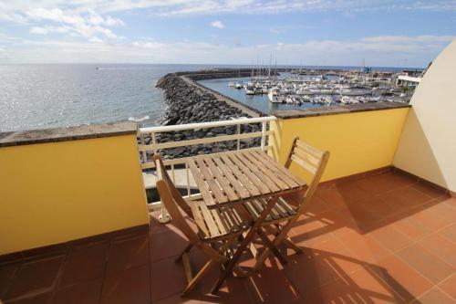 Балкон или терраса в Vinha da Areia Beach Hotel