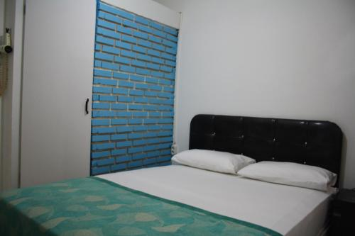 A bed or beds in a room at Beyaz Butik Hotel