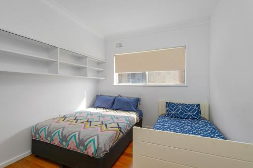 A bed or beds in a room at The Beach House, 1/65 Pacific Street, Port Macquarie