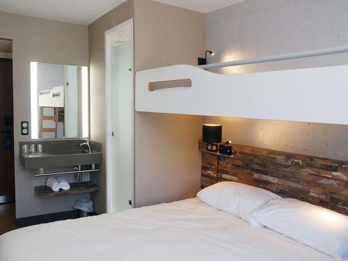 Un ou plusieurs lits dans un hébergement de l'établissement ibis budget Annecy Poisy