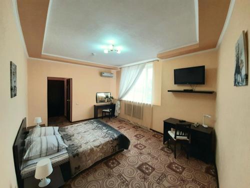 Телевизор и/или развлекательный центр в Hotel Dio Lakrua