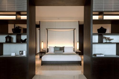 A bed or beds in a room at Soori Bali