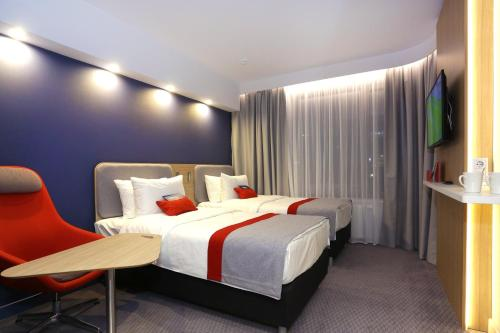 A bed or beds in a room at Holiday Inn Express - Moscow - Paveletskaya, an IHG Hotel