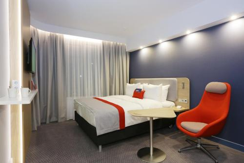 A bed or beds in a room at Holiday Inn Express - Moscow - Paveletskaya
