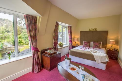 A bed or beds in a room at The Glendalough Hotel