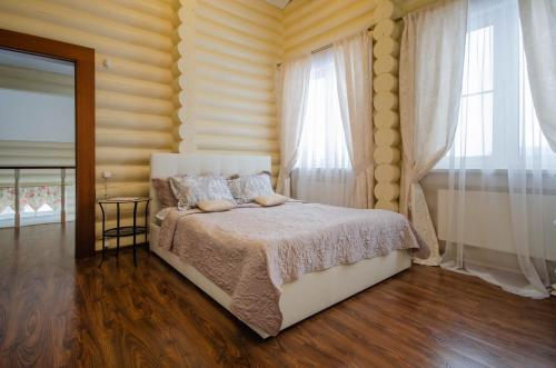 A bed or beds in a room at Country House