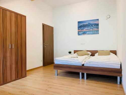 Ein Bett oder Betten in einem Zimmer der Unterkunft Cozy room im Salzburg