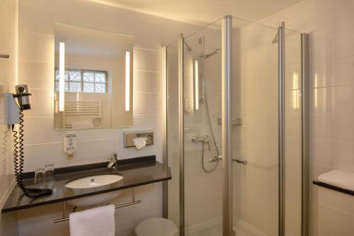 Koupelna v ubytování Posthotel Kolberbräu