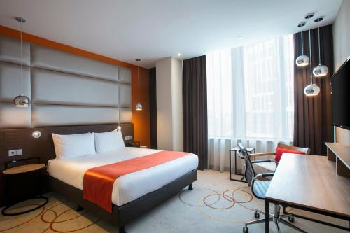 A bed or beds in a room at Holiday Inn Amsterdam - Arena Towers