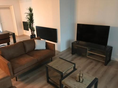 Een TV en/of entertainmentcenter bij VAKANTIE WONING OASE