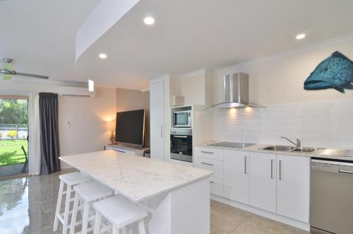 A kitchen or kitchenette at Reef Terraces on St Crispins
