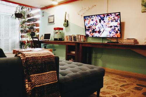 A television and/or entertainment center at La Playa Hostel & Rooftop