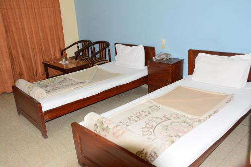 A bed or beds in a room at Hotel Alpine